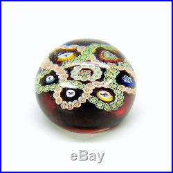 Antique BACCARAT paperweight animal canes red background