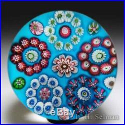 Antique Clichy circular millefiori garland on blue ground glass paperweight