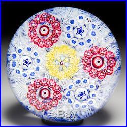 Baccarat 1973 millefiori circlets on upset muslin glass paperweight