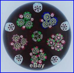 Paul Ysart Paperweight, Clusters of Millefiori on translucent cranberry