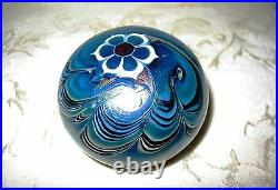 Signed Lundberg Studio Art Glass Iridescent Paperweight with a Floral Design