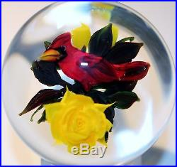 Signed Rick Ayotte Glass Paperweight Cardinal on three yellow roses